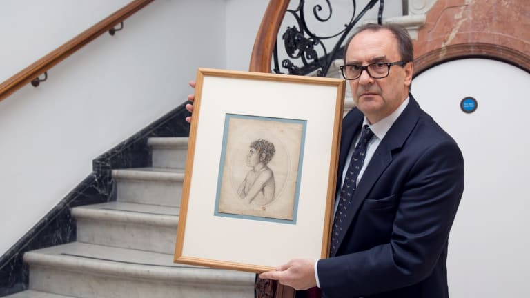 Christie's director Nick Lambourn holds a pencil drawing of Toulgra.