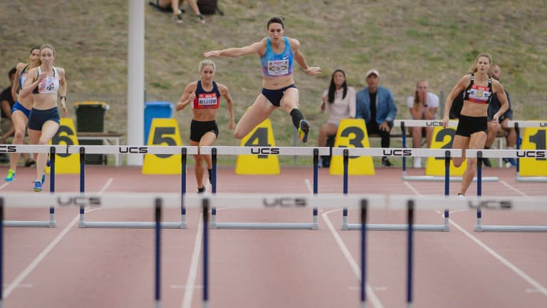 Canberra's Lauren Wells wins the 400 metre hurdles convincingly. Photo: Sitthixay Ditthavong