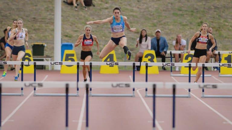 Canberra's Lauren Wells wins the 400 metre hurdles convincingly. Photo: Sitthixay Ditthavong