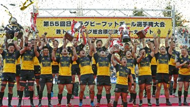 Suntory Sungoliath celebrate defending their title after beating Panasonic Wild Knights 12-8 in the Top League final.