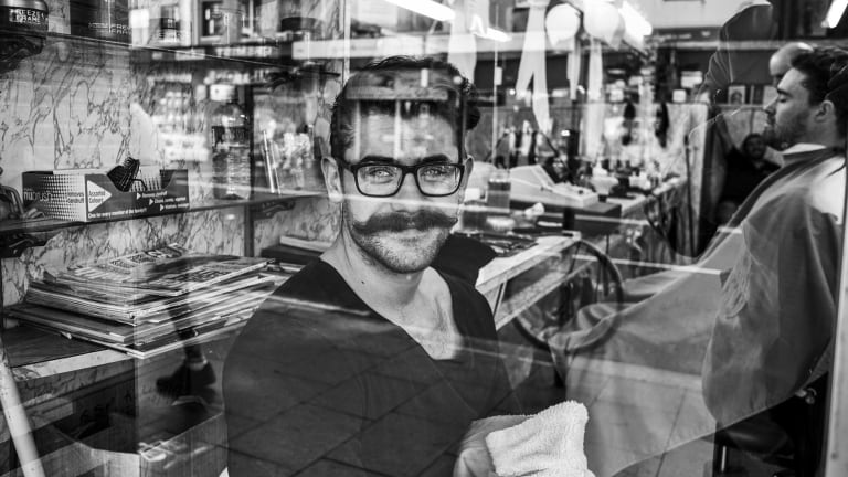 Australian Life photography prize winner <em>Barber Shop</em> is on show with the other 21 finalists in Sydney's Hyde Park.