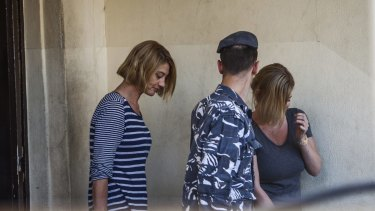 Tara Brown, left, and Australian mother Sally Faulkner, right, leave a women's prison in the Beirut suburb of Baabda.
