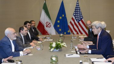 US Secretary of State John Kerry speaks with Iranian Foreign Minister Mohammad Javad Zarif in Geneva on Saturday.