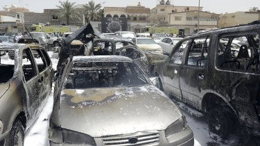 Damaged cars outside the Shiite mosque in Dammam.