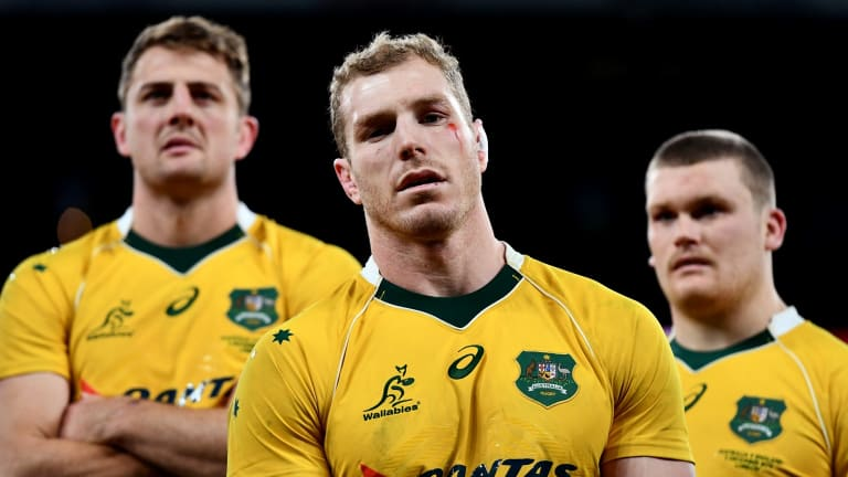 David Pocock of Australia (C) looks dejected after the final whistle during the Old Mutual Wealth Series match between England and Australia at Twickenham.