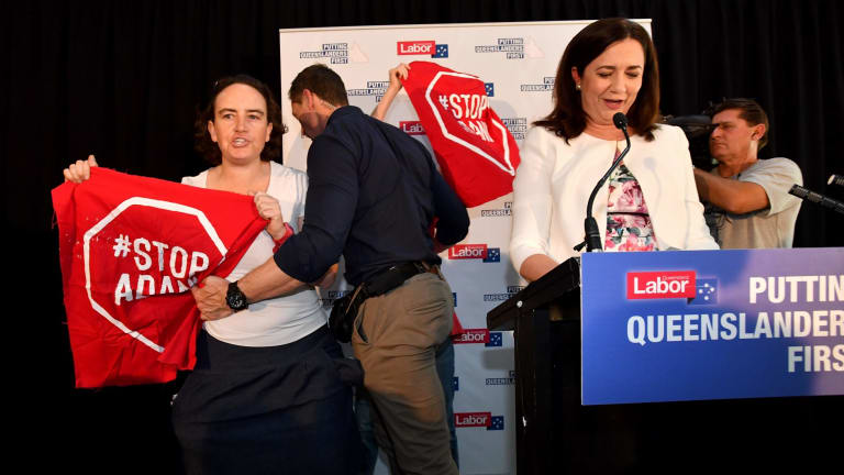 Adani protesters try to interrupt Queensland Premier Annastacia Palaszczuk on the first day of the recent state election campaign.