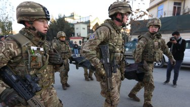British soldiers carry the body of a victim of an attack  near the Spanish Embassy, in Kabul, last week.