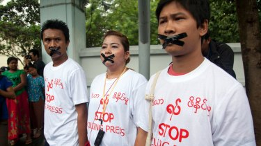 Myanmar journalist Thet Oo Maung, known as Wa Lone, right, stands in 2014 with other journalists with their mouths taped, symbolising the government's crackdown on the media.