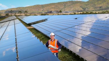Sun Metals Corporation's Solar Project Manager Lance Moody inspects progress of the solar panels at Sun Metals.