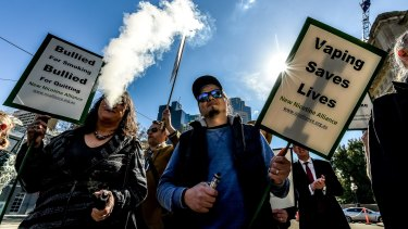 Beneath clouds of sickly sweet vapour the protesters rallied for their right to use electronic devices.