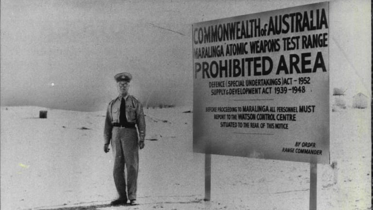 A police guard at one of the entries to the Maralinga atomic weapons test range.