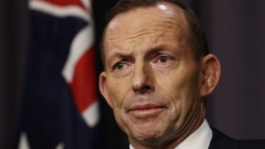 """Prime Minister Tony Abbott refused to comment on reports the Vietnamese asylum seekers had been returned, saying it wasn't his government's job to """"run a shipping news service for people smugglers""""."""