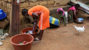A woman washes clothes in the village of Tanah, Guinea, earlier this month. After killing more than 11,000 people, West Africa's Ebola outbreak is down to a handful of cases.