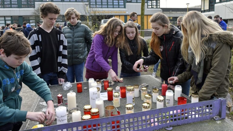 Students light candles at the Joseph-Koenig Gymnasium in Haltern, Germany. Sixteen school children and two teachers from Haltern are among the victims.