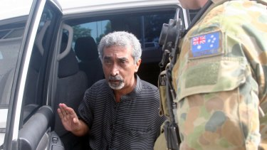 Former East Timorese prime minister Mari Alkatiri, flanked by an Australian soldier in 2006.