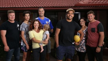 Clem Smith with the Christie family (left to right: Jake, Tyler, parents Mick and Leah, Monique and her fiancee Joey) at home.