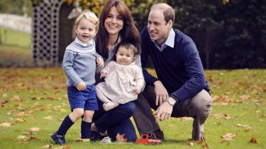 The Duke and Duchess of Cambridge with their two children, Prince George and Princess Charlotte, in a photograph taken late October 2015 at Kensington Palace in London.