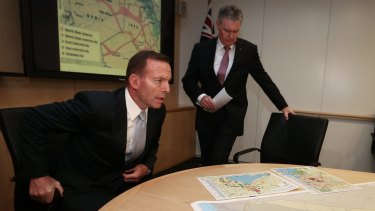 Then prime minister Tony Abbott is briefed by ASIO director-general Duncan Lewis on Islamic State in June.