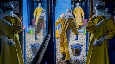 Workers enter the high-risk zone of the Bong County Ebola Treatment Unit in Suakoko, Liberia during the height of the Ebola crisis last year.