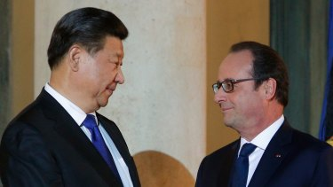 France's President Francois Hollande welcomes Chinese President Xi Jinping to Paris for the COP21 climate summit in November.