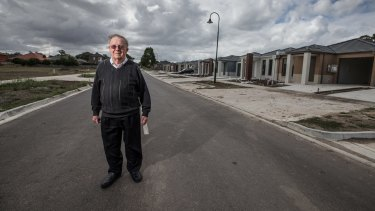 Jack Mercovich in front of a row of new housing in his suburb of South Morang.