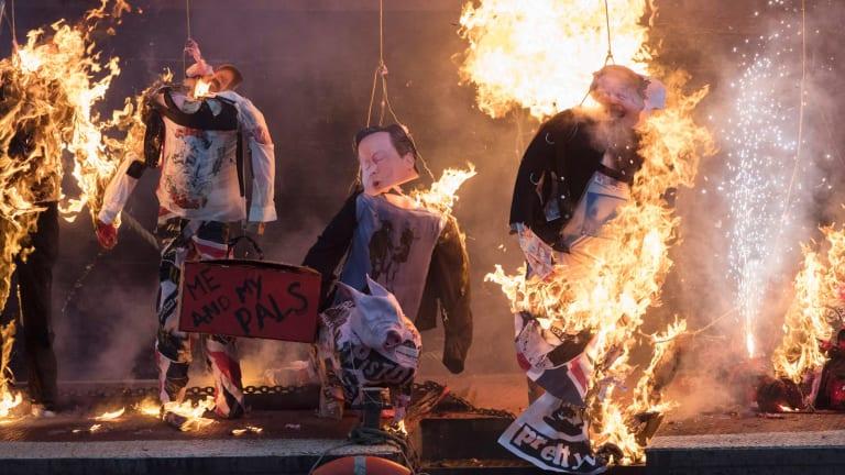 Effigies of British political figures were set ablaze as part of Saturday's protest.