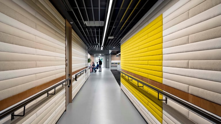 The walls at Vision Australia headquarters are a mix of fabric and timber.