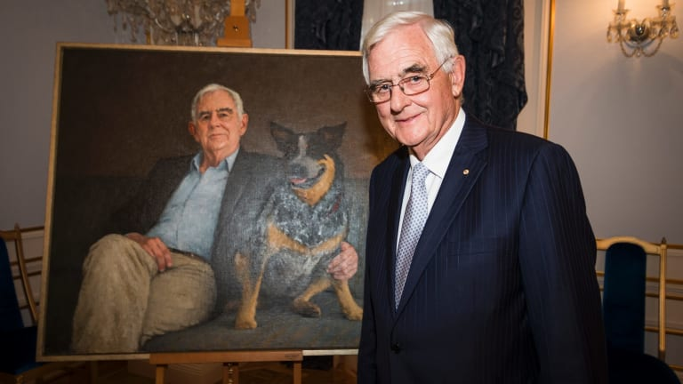 Terry Snow with his portrait.