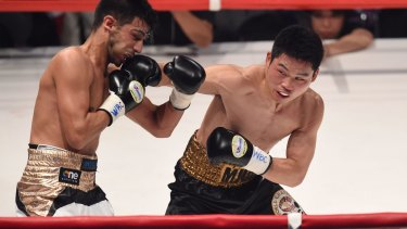 Takashi Miura lands a punch on Billy Dib's chin.