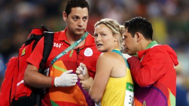Mickle is assisted by medical staff after dislocating her shoulder at the Rio Olympics.