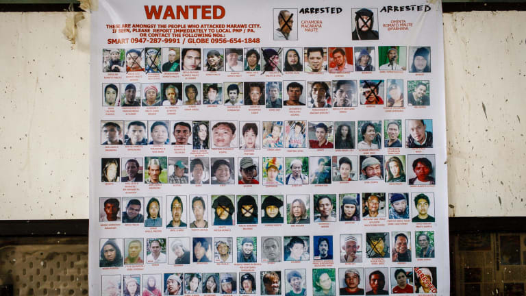 A poster of wanted terrorists in the Marawi area.