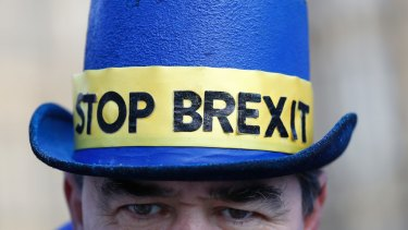 An anti Brexit demonstrator wears a hat in Westminster in London.