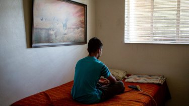 A 15-year-old boy from El Salvador in his uncle's home in Tucson, Arizona this month. He is asking for asylum after fleeing gang violence back home, but did not have a lawyer in immigration court.