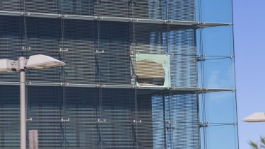 A broken window at the ASIO headquarters last year.