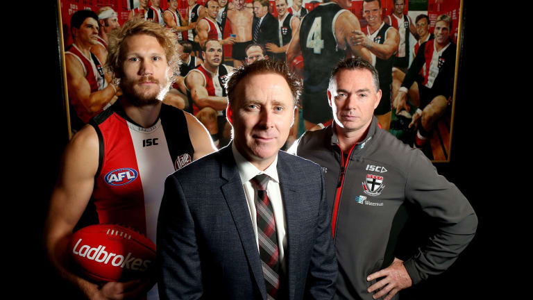 St Kilda lobbied for a pride game and have been given the go-ahead for a themed fixture against Sydney in round 21. Pictured are St Kilda footballer Sam Gilbert, CEO Matt Finnis and coach Alan Richardson.
