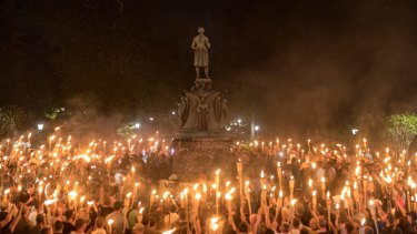Torch-bearing white nationalists rally around a statue in Charlottesville.