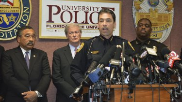 Tallahassee Police Chief Michael DeLeo, front, speaks during a news conference with Mayor John Marks (L to R), Florida State University president John Thrasher and campus police Chief David Perry.