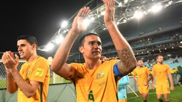Australia's Tim Cahill (centre) and Tomas Rogic (left) applaud the crowd after their win over Syria at ANZ Stadium in October.