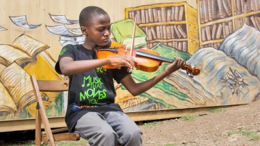 The children report feeling stronger and happier when they play their instrument.