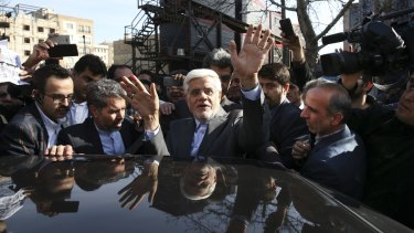 Head of the reformists' coalition list of the Iranian parliamentary elections in Tehran, Mohammad Reza Aref waves as he gets into his car after casting his vote at a polling station in northern Tehran.