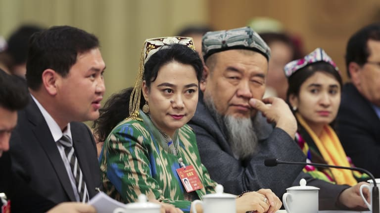Delegates from Xinjiang attend the Xinjiang group meeting at the Great Hall Of The People in Beijing on March 12.