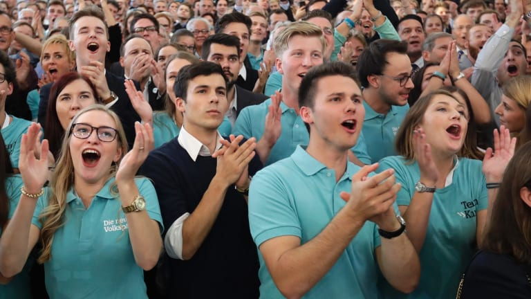 Supporters of Austrian People's Party celebrate  in Vienna after the first exit polls were published.