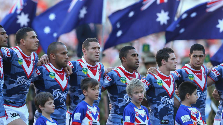 Roosters players pause for a minute's silence before the 2013 clash with St George Illawarra.
