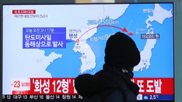 A man watches a TV screen showing a local news program reporting North Korea's missile launch at the Seoul Train Station in Seoul on Wednesday.