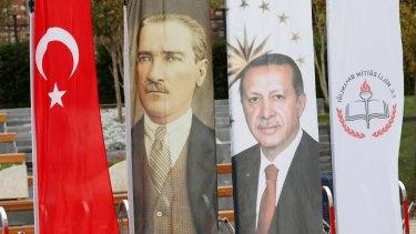 Banners with pictures of modern Turkey's founder Ataturk and Turkish President Tayyip Erdogan adorn the opening ceremony of Recep Tayyip Erdogan Imam Hatip School in Istanbul, Turkey.