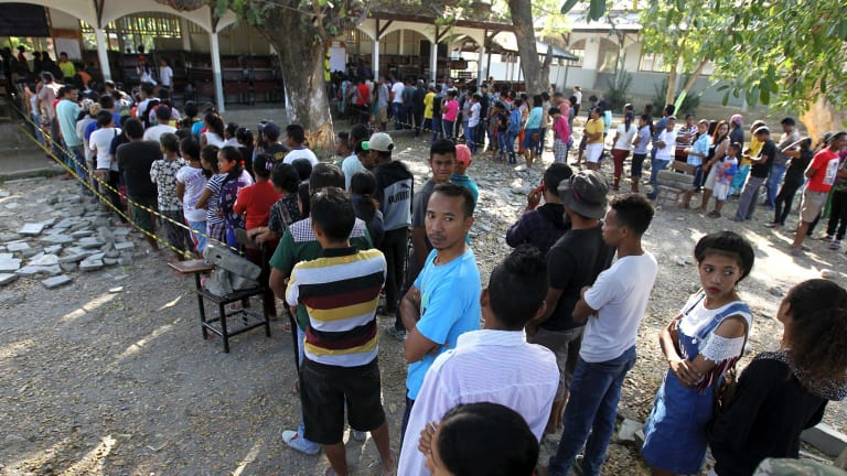 People line up to vote in Dili.