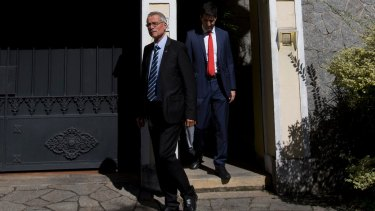 French investigative magistrate Renaud van Ruymbeke leaves the residence of Carlos Nuzman in Rio on Tuesday.