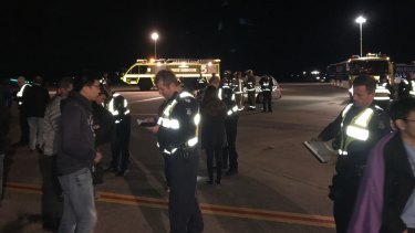 Passengers from the Malaysia Airlines plane on the tarmac.