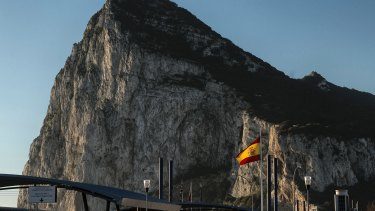 A Spanish flag flies on the top of the customs house on the Spanish side of the border.