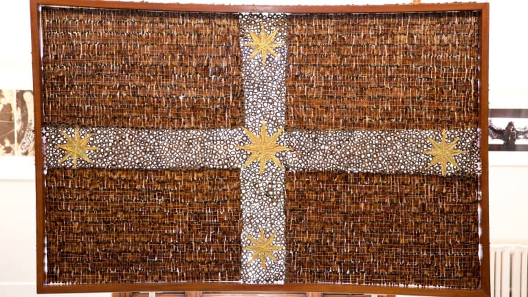 Donna Fortescue's  Beneath the Southern Cross We Stand, made with jarrah, red gum, gumnuts and sticks, xanthorrhoea resin and fronds, banksia leaves, hessian, braid, charcoal, rabbit skin glue, aluminium and cotton thread.
